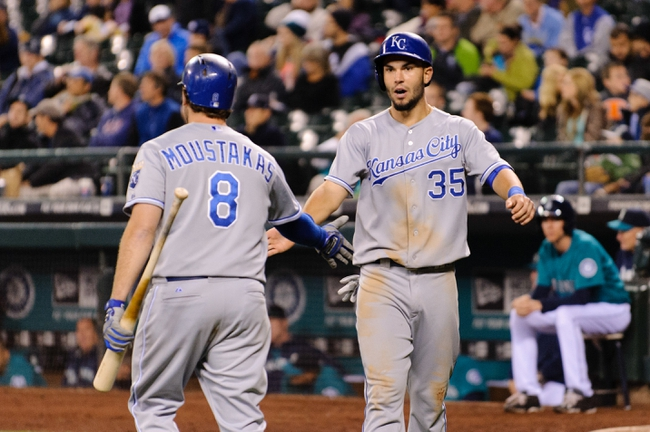 Sep 23, 2013; Seattle, WA, USA; Kansas City Royals third baseman Mike Moustakas (8) and Kansas City Royals first baseman Eric Hosmer (35) celebrate after Hosmer scored a run against the Seattle Mariners off a RBI single hit by Kansas City Royals catcher Salvador Perez (13) (not pictured) during the 8th inning at Safeco Field. Mandatory Credit: Steven Bisig-USA TODAY Sports