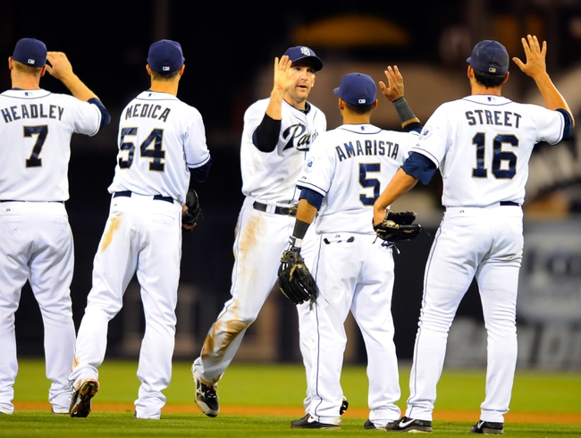 Sep 23, 2013; San Diego, CA, USA; San Diego Padres center fielder Chris Denorfia (center) celebrates with teammates after a win against the Arizona Diamondbacks at Petco Park. The Padres won 4-1. Mandatory Credit: Christopher Hanewinckel-USA TODAY Sports