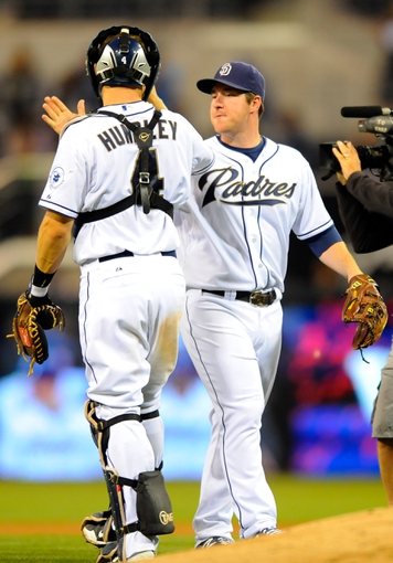 Sep 23, 2013; San Diego, CA, USA; San Diego Padres second baseman Jedd Gyorko (9) celebrates with catcher Nick Hundley (4) after a win against the Arizona Diamondbacks at Petco Park. The Padres won 4-1. Mandatory Credit: Christopher Hanewinckel-USA TODAY Sports