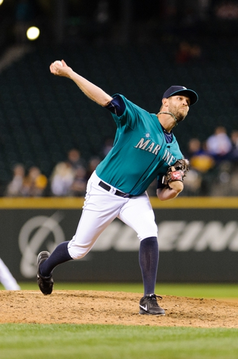 Sep 23, 2013; Seattle, WA, USA; Seattle Mariners relief pitcher Tom Wilhelmsen (54) pitches to the Kansas City Royals during the 8th inning at Safeco Field. Mandatory Credit: Steven Bisig-USA TODAY Sports
