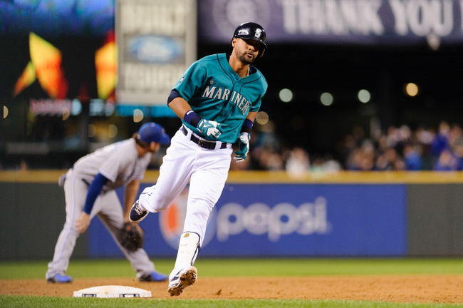 Sep 23, 2013; Seattle, WA, USA; Seattle Mariners pinch hitter Franklin Gutierrez (21) rounds 3rd base after hitting a solo home run against the Kansas City Royals during the 8th inning at Safeco Field. Mandatory Credit: Steven Bisig-USA TODAY Sports