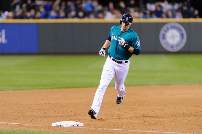 Sep 23, 2013; Seattle, WA, USA; Seattle Mariners pinch hitter Michael Saunders (55) rounds 3rd base after hitting a solo home run against the Kansas City Royals during the 8th inning at Safeco Field. Mandatory Credit: Steven Bisig-USA TODAY Sports