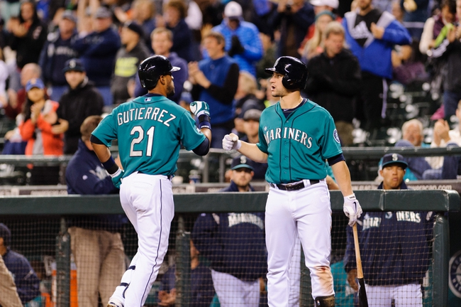 Sep 23, 2013; Seattle, WA, USA; Seattle Mariners pinch hitter Franklin Gutierrez (21) celebrates with Seattle Mariners catcher Mike Zunino (3) after Gutierrez hit a solo home run against the Kansas City Royals during the 8th inning at Safeco Field. Mandatory Credit: Steven Bisig-USA TODAY Sports