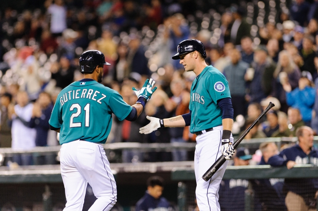 Sep 23, 2013; Seattle, WA, USA; Seattle Mariners pinch hitter Franklin Gutierrez (21) and Seattle Mariners pinch hitter Michael Saunders (55) celebrate after Gutierrez hit a solo home run against the Kansas City Royals during the 8th inning at Safeco Field. Mandatory Credit: Steven Bisig-USA TODAY Sports