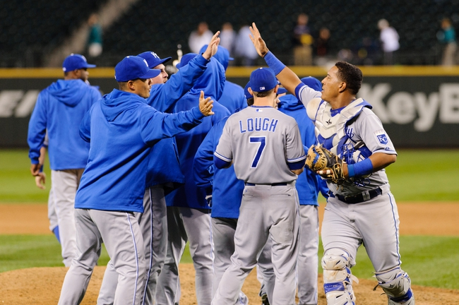 Sep 23, 2013; Seattle, WA, USA; The Kansas City Royals celebrate after defeating the Seattle Mariners in the 12th inning at Safeco Field. Kansas City defeated Seattle 6-5. Mandatory Credit: Steven Bisig-USA TODAY Sports