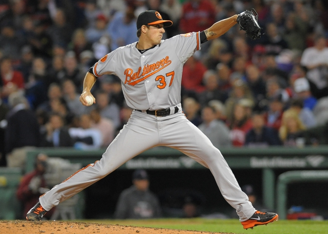 Sep 17, 2013; Boston, MA, USA; Baltimore Orioles relief pitcher Kevin Gausman (37) pitches during the seventh inning against the Boston Red Sox at Fenway Park. Mandatory Credit: Bob DeChiara-USA TODAY Sports