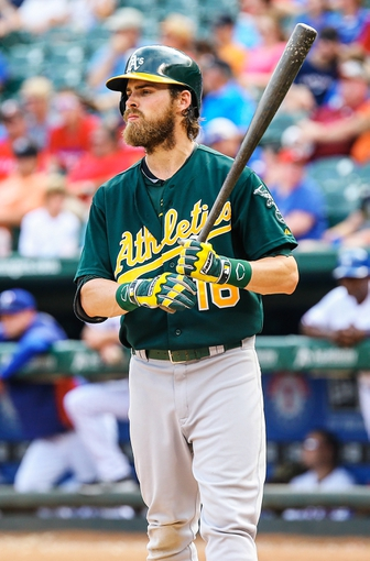 Sep 15, 2013; Arlington, TX, USA; Oakland Athletics right fielder Josh Reddick (16) bats during the game against the Texas Rangers at Rangers Ballpark in Arlington. Oakland won 5-1. Mandatory Credit: Kevin Jairaj-USA TODAY Sports