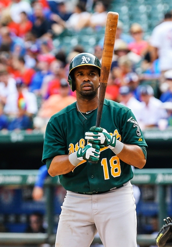 Sep 15, 2013; Arlington, TX, USA; Oakland Athletics second baseman Alberto Callaspo (18) bats during the game against the Texas Rangers at Rangers Ballpark in Arlington. Oakland won 5-1. Mandatory Credit: Kevin Jairaj-USA TODAY Sports