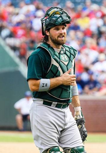 Sep 15, 2013; Arlington, TX, USA; Oakland Athletics catcher Derek Norris (36) laughs during the game against the Texas Rangers at Rangers Ballpark in Arlington. Oakland won 5-1. Mandatory Credit: Kevin Jairaj-USA TODAY Sports