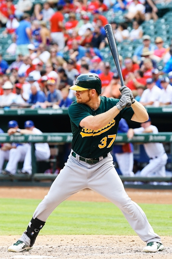 Sep 15, 2013; Arlington, TX, USA; Oakland Athletics first baseman Brandon Moss (37) bats during the game against the Texas Rangers at Rangers Ballpark in Arlington. Oakland won 5-1. Mandatory Credit: Kevin Jairaj-USA TODAY Sports