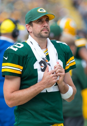 Sep 15, 2013; Green Bay, WI, USA;  Green Bay Packers quarterback Aaron Rodgers (12) during the game against the Washington Redskins at Lambeau Field.  Green Bay won 38-20.  Mandatory Credit: Jeff Hanisch-USA TODAY Sports