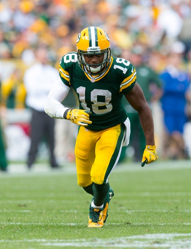 Sep 15, 2013; Green Bay, WI, USA;  Green Bay Packers wide receiver Randall Cobb (18) during the game against the Washington Redskins at Lambeau Field.  Green Bay won 38-20.  Mandatory Credit: Jeff Hanisch-USA TODAY Sports