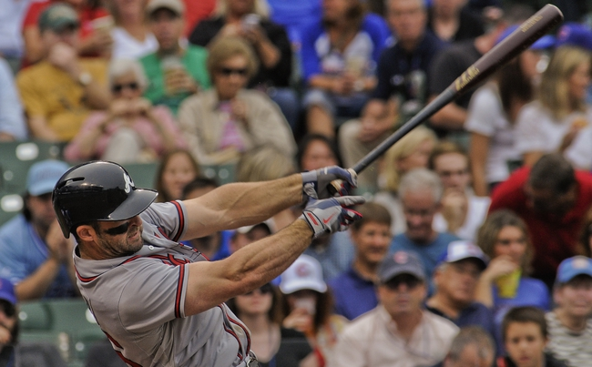 Sep 20, 2013; Chicago, IL, USA; Atlanta Braves infielder Dan Uggla bats during their game against the Chicago Cubs at Wrigley Field. Mandatory Credit: Matt Marton-USA TODAY Sports