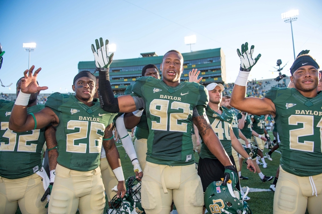 Sep 21, 2013; Waco, TX, USA; Baylor Bears safety Taion Sells (26) and defensive end Jamal Palmer (92) and safety Patrick Levels (21) celebrate the win over the Louisiana Monroe Warhawks at Floyd Casey Stadium. The Bears defeated the Warhawks 70-7. Mandatory Credit: Jerome Miron-USA TODAY Sports