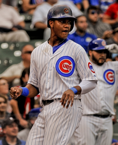 Sep 20, 2013; Chicago, IL, USA; Chicago Cubs infielder Starlin Castro crosses the plate in their game against the Atlanta Braves at Wrigley Field. Mandatory Credit: Matt Marton-USA TODAY Sports