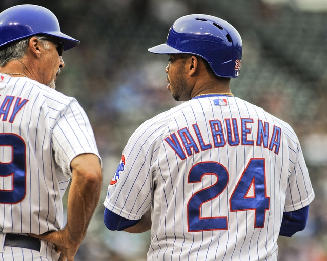 Sep 20, 2013; Chicago, IL, USA; Chicago Cubs infielder Luis Valbuena and first base coach Davis McCay chat in their game against the Atlanta Braves at Wrigley Field. Mandatory Credit: Matt Marton-USA TODAY Sports