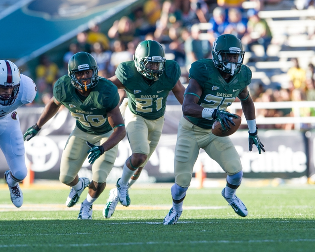 Sep 21, 2013; Waco, TX, USA; Baylor Bears linebacker Aiavion Edwards (20) and safety Patrick Levels (21) and safety Taion Sells (26) during the game against the Louisiana Monroe Warhawks at Floyd Casey Stadium. The Bears defeated the Warhawks 70-7. Mandatory Credit: Jerome Miron-USA TODAY Sports