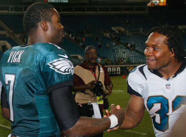 Aug 24, 2013; Jacksonville, FL, USA; Philadelphia Eagles quarterback Michael Vick (7) greets Jacksonville Jaguars running back Maurice Jones-Drew (32) after their game at EverBank Field. The Philadelphia Eagles beat the Jacksonville Jaguars 31-24. Mandatory Credit: Phil Sears-USA TODAY Sports