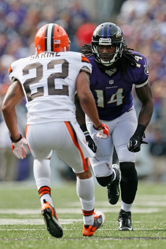 Sep 15, 2013; Baltimore, MD, USA; Baltimore Ravens wide receiver Marlon Brown (14) defended by Cleveland Browns defensive back Buster Skrine (22) at M&T Bank Stadium. Mandatory Credit: Mitch Stringer-USA TODAY Sports