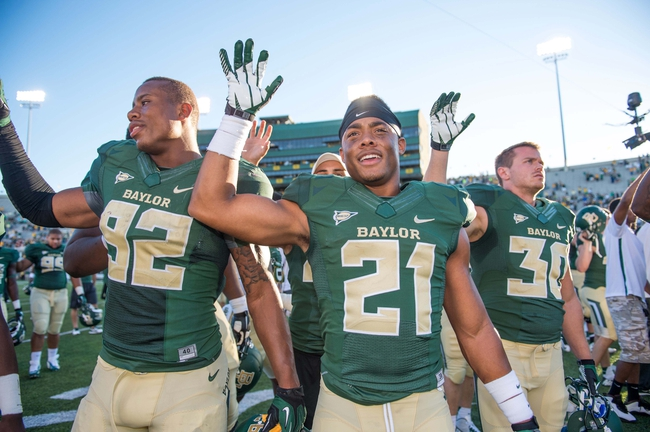 Sep 21, 2013; Waco, TX, USA; Baylor Bears defensive end Jamal Palmer (92) and safety Patrick Levels (21) celebrate the win over the Louisiana Monroe Warhawks at Floyd Casey Stadium. The Bears defeated the Warhawks 70-7. Mandatory Credit: Jerome Miron-USA TODAY Sports