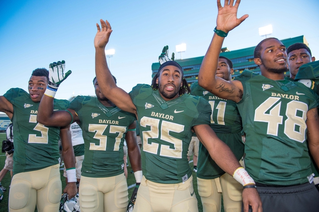 Sep 21, 2013; Waco, TX, USA; Baylor Bears running back Lache Seastrunk (25) celebrates the win over the Louisiana Monroe Warhawks at Floyd Casey Stadium. The Bears defeated the Warhawks 70-7. Mandatory Credit: Jerome Miron-USA TODAY Sports