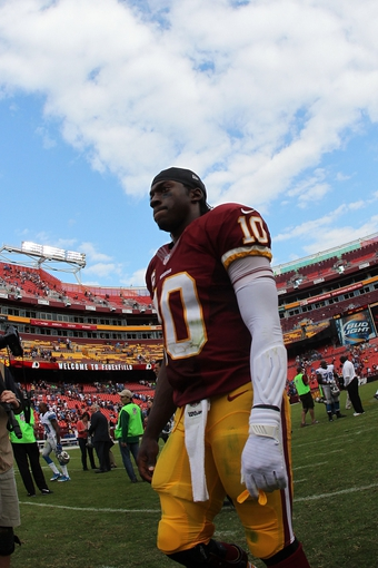 Sep 22, 2013; Landover, MD, USA; Washington Redskins quarterback Robert Griffin III (10) leaves the field after the Redskins game against the Detroit Lions at FedEx Field. The Lions won 27-20. Mandatory Credit: Geoff Burke-USA TODAY Sports