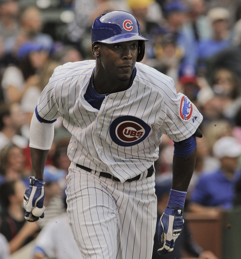 Sep 20, 2013; Chicago, IL, USA; Chicago Cubs outfielder Junior Lake heads to first base in their game against the Atlanta Braves at Wrigley Field. Mandatory Credit: Matt Marton-USA TODAY Sports