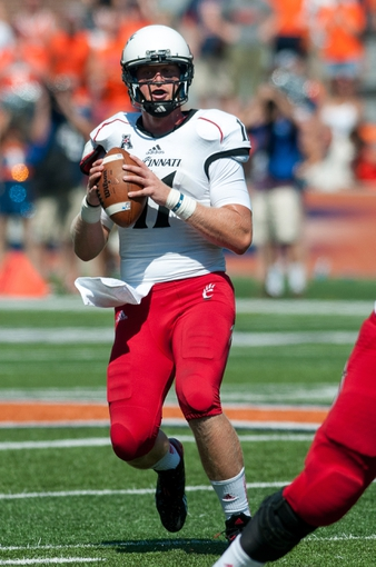 Sep 7, 2013; Champaign, IL, USA; Cincinnati Bearcats quarterback Brendon Kay (11) during the game against the Illinois Fighting Illini at Memorial Stadium. Mandatory Credit: Bradley Leeb-USA TODAY Sports