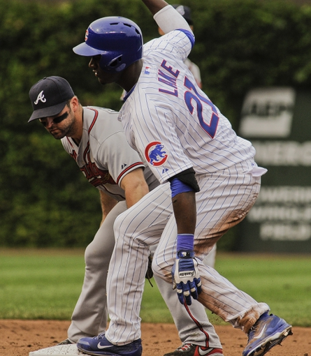 Sep 20, 2013; Chicago, IL, USA; Chicago Cubs outfielder Junior Lake at second base against Atlanta Braves infielder Dan Uggla at Wrigley Field. Mandatory Credit: Matt Marton-USA TODAY Sports