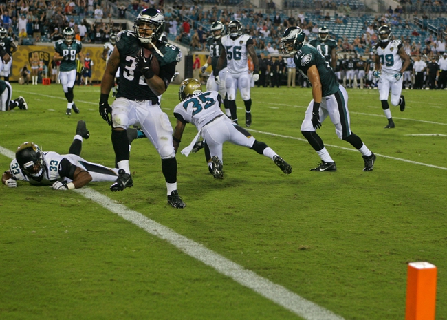 Aug 24, 2013; Jacksonville, FL, USA; Philadelphia Eagles running back Chris Polk (32) scores the game-winning touchdown during the fourth quarter of their game against the Jacksonville Jaguars at EverBank Field. The Philadelphia Eagles beat the Jacksonville Jaguars 31-24. Mandatory Credit: Phil Sears-USA TODAY Sports