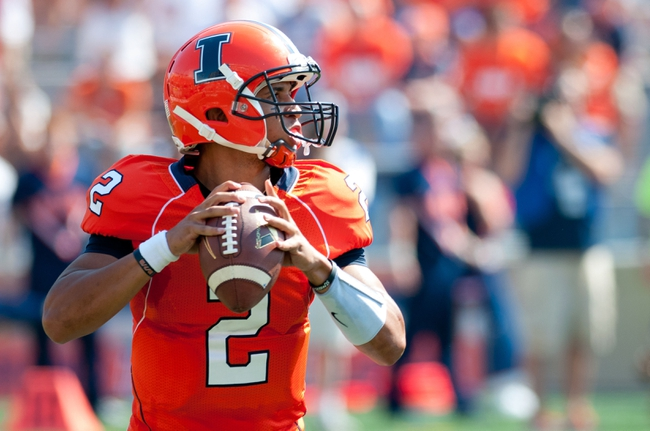 Sep 7, 2013; Champaign, IL, USA; Illinois Fighting Illini quarterback Nathan Scheelhaase (2) during the first quarter against the Cincinnati Bearcats at Memorial Stadium. Mandatory Credit: Bradley Leeb-USA TODAY Sports