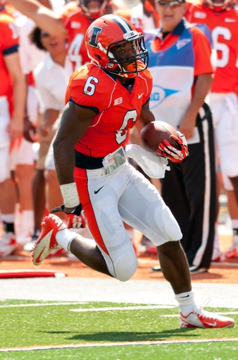 Sep 7, 2013; Champaign, IL, USA; Illinois Fighting Illini running back Josh Ferguson (6) runs the ball during the game against the Cincinnati Bearcats at Memorial Stadium. Mandatory Credit: Bradley Leeb-USA TODAY Sports