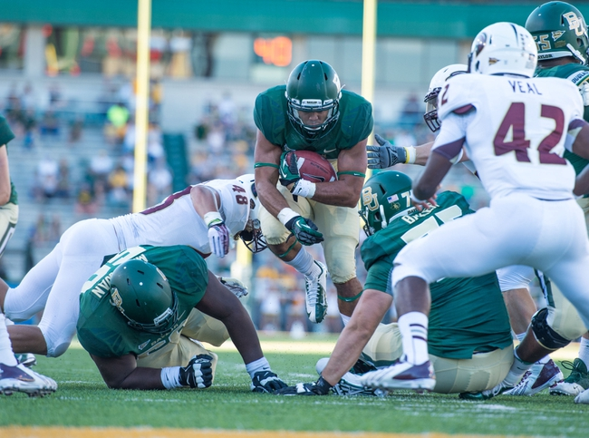 Sep 21, 2013; Waco, TX, USA; Baylor Bears running back Devin Chafin (28) runs past Louisiana Monroe Warhawks linebacker Hunter Kissinger (48) during the game at Floyd Casey Stadium. The Bears defeated the Warhawks 70-7. Mandatory Credit: Jerome Miron-USA TODAY Sports