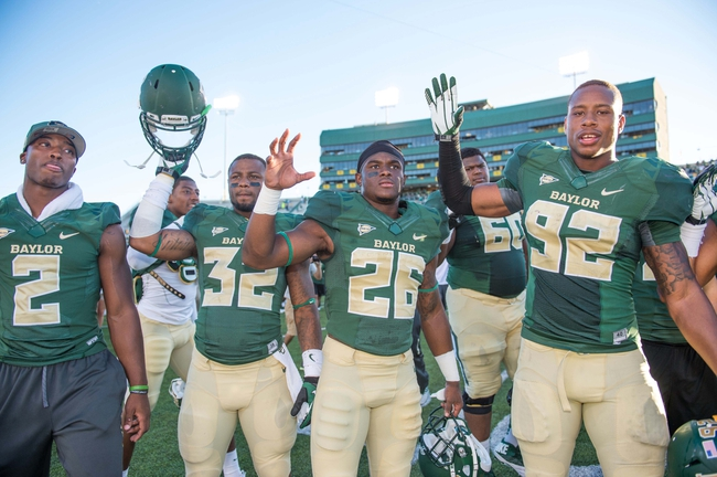 Sep 21, 2013; Waco, TX, USA; Baylor Bears running back Shock Linwood (32) and safety Taion Sells (26) and defensive end Jamal Palmer (92) celebrate the win over the Louisiana Monroe Warhawks at Floyd Casey Stadium. The Bears defeated the Warhawks 70-7. Mandatory Credit: Jerome Miron-USA TODAY Sports