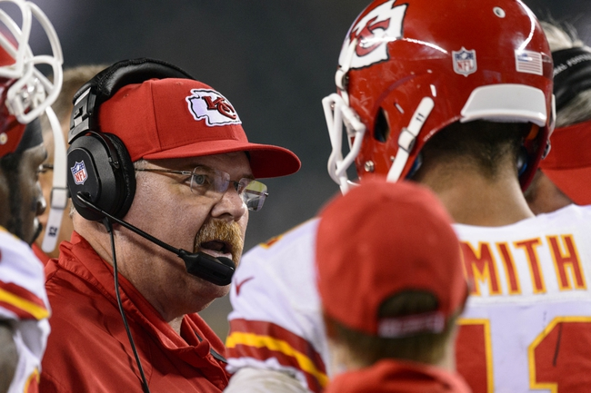 Sep 19, 2013; Philadelphia, PA, USA; Kansas City Chiefs head coach Andy Reid talks with quarterback Alex Smith (11) during the fourth quarter against the Philadelphia Eagles at Lincoln Financial Field. The Chiefs defeated the Eagles 26-16. Mandatory Credit: Howard Smith-USA TODAY Sports