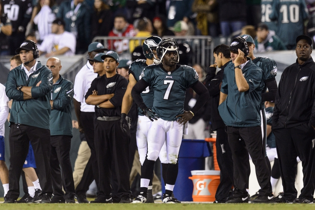 Sep 19, 2013; Philadelphia, PA, USA; Philadelphia Eagles quarterback Michael Vick (7) along the sidelines during the fourth quarter against the Kansas City Chiefs at Lincoln Financial Field. The Chiefs defeated the Eagles 26-16. Mandatory Credit: Howard Smith-USA TODAY Sports