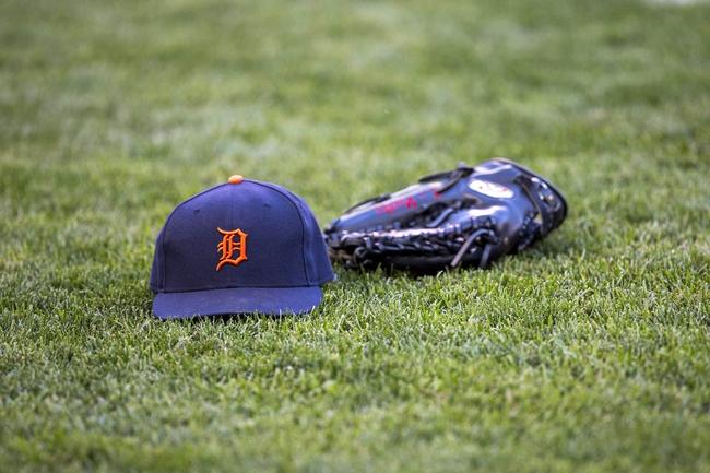 Sep 24, 2013; Minneapolis, MN, USA; A general view of a Detroit Tigers hat a glove before a game against the Minnesota Twins at Target Field. Mandatory Credit: Jesse Johnson-USA TODAY Sports