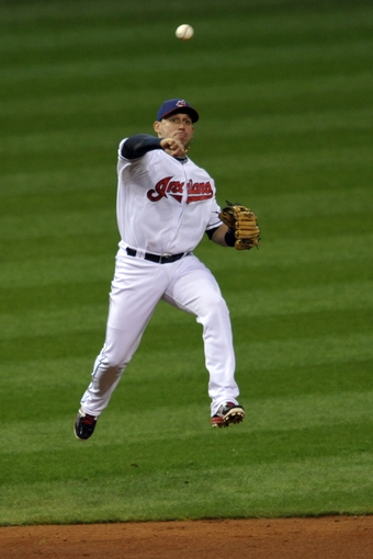 Sep 24, 2013; Cleveland, OH, USA; Cleveland Indians shortstop Asdrubal Cabrera (13) throws to first base on an infield hit by Chicago White Sox right fielder Avisail Garcia (not pictured) in the second inning at Progressive Field. Mandatory Credit: David Richard-USA TODAY Sports