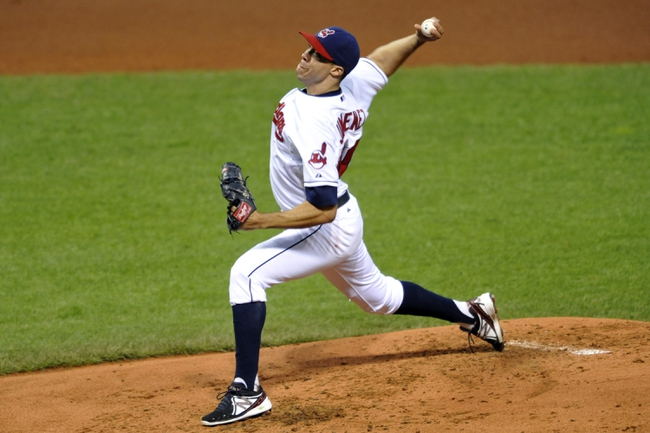 Sep 24, 2013; Cleveland, OH, USA; Cleveland Indians starting pitcher Ubaldo Jimenez (30) delivers in the second inning against the Chicago White Sox at Progressive Field. Mandatory Credit: David Richard-USA TODAY Sports