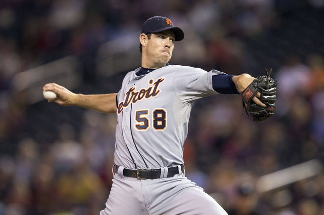 Sep 24, 2013; Minneapolis, MN, USA; Detroit Tigers starting pitcher Doug Fister (58) delivers a pitch in the first inning against the Minnesota Twins at Target Field. Mandatory Credit: Jesse Johnson-USA TODAY Sports