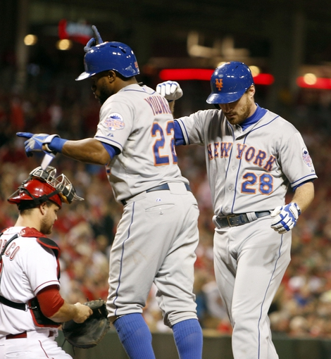 Sep 24, 2013; Cincinnati, OH, USA; New York Mets second baseman Daniel Murphy (28) is congratulated by left fielder Eric Young Jr. (22) after Murphy hit a three-run home run off Cincinnati Reds starting pitcher Mike Leake (not pictured) in the second inning at Great American Ball Park. Mandatory Credit: David Kohl-USA TODAY Sports