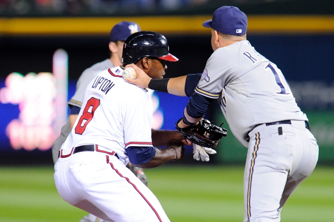 Sep 24, 2013; Atlanta, GA, USA; Atlanta Braves right fielder Justin Upton (8) is tagged out by Milwaukee Brewers third baseman Aramis Ramirez (16) after being caught in a run down during the sixth inning at Turner Field. Mandatory Credit: Dale Zanine-USA TODAY Sports