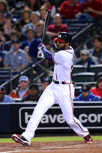 Sep 24, 2013; Atlanta, GA, USA; Atlanta Braves center fielder Jason Heyward (22) gets a base hit against the Milwaukee Brewers during the sixth inning at Turner Field. Mandatory Credit: Dale Zanine-USA TODAY Sports