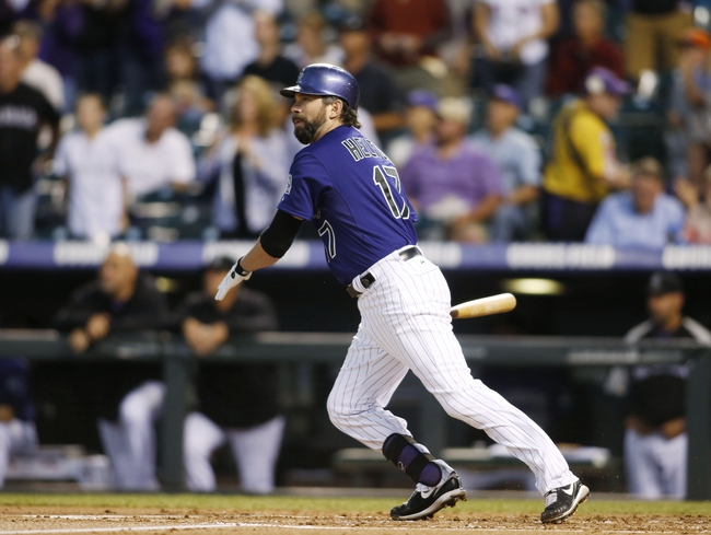 Sep 24, 2013; Denver, CO, USA; Colorado Rockies first baseman Todd Helton (17) hits an RBI single during the first inning against the Boston Red Sox at Coors Field. Mandatory Credit: Chris Humphreys-USA TODAY Sports