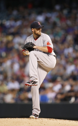 Sep 24, 2013; Denver, CO, USA; Boston Red Sox pitcher John Lackey (41) delivers a pitch during the first inning against the Colorado Rockies at Coors Field.  Mandatory Credit: Chris Humphreys-USA TODAY Sports
