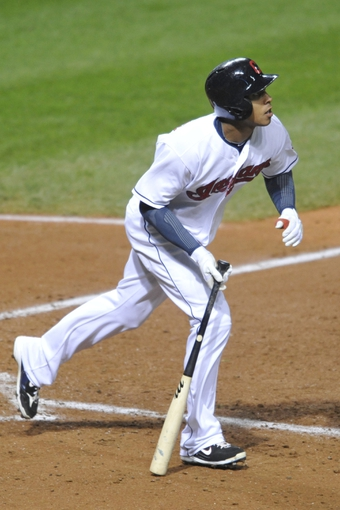 Sep 24, 2013; Cleveland, OH, USA; Cleveland Indians left fielder Michael Brantley (23) watches his solo home run in the seventh inning against the Chicago White Sox at Progressive Field. Mandatory Credit: David Richard-USA TODAY Sports