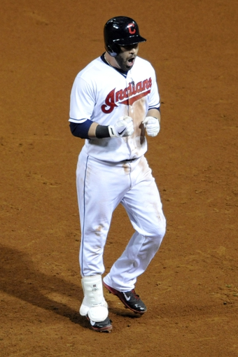 Sep 24, 2013; Cleveland, OH, USA; Cleveland Indians second baseman Jason Kipnis (22) celebrates his RBI single in the seventh inning against the Chicago White Sox at Progressive Field. Mandatory Credit: David Richard-USA TODAY Sports
