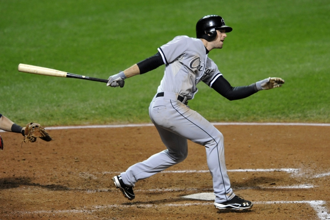 Sep 24, 2013; Cleveland, OH, USA; Chicago White Sox third baseman Conor Gillaspie (12) hits a double in the sixth inning against the Cleveland Indians at Progressive Field. Mandatory Credit: David Richard-USA TODAY Sports