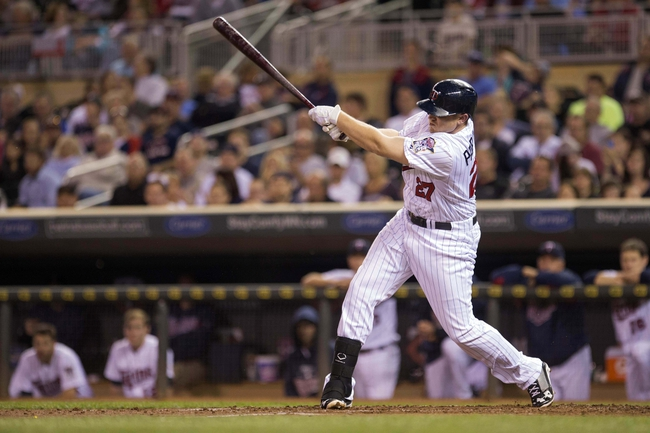 Sep 24, 2013; Minneapolis, MN, USA; Minnesota Twins right fielder Chris Parmelee (27) hits a RBI single in the second inning against the Detroit Tigers at Target Field. Mandatory Credit: Jesse Johnson-USA TODAY Sports