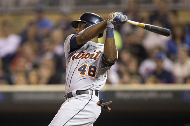 Sep 24, 2013; Minneapolis, MN, USA;Detroit Tigers right fielder Torii Hunter (48) hits a single in the third inning against the Minnesota Twins at Target Field. Mandatory Credit: Jesse Johnson-USA TODAY Sports
